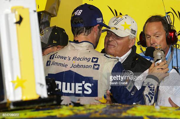 Jimmie Johnson driver of the Lowe's Chevrolet celebrates with team owner Rick Hendrick in Victory Lane after winning the NASCAR Sprint Cup Series...