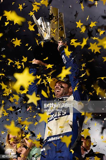 Jimmie Johnson, driver of the Lowe's Chevrolet, celebrates with the NASCAR Sprint Cup Series Championship trophy in Victory Lane after winning the...
