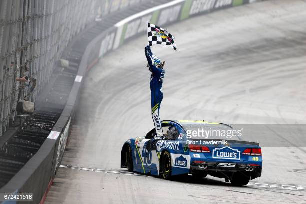 Jimmie Johnson driver of the Lowe's Chevrolet celebrates with the checkered flag after winning the Monster Energy NASCAR Cup Series Food City 500 at...