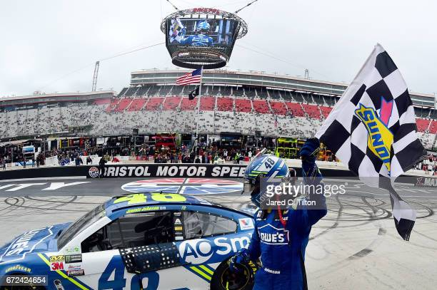 Jimmie Johnson, driver of the Lowe's Chevrolet, celebrates with the checkered flag after winning the Monster Energy NASCAR Cup Series Food City 500...