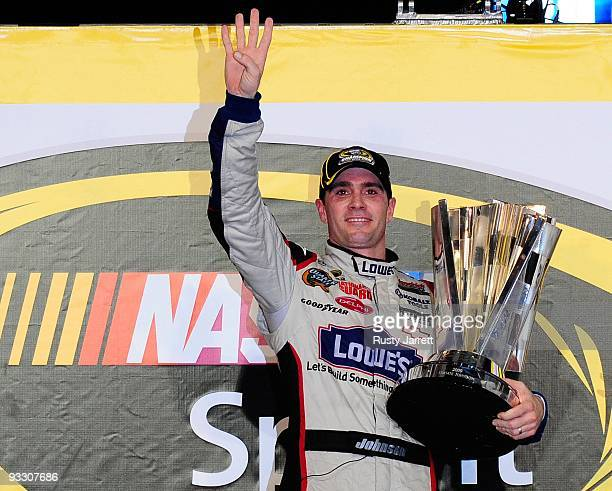 Jimmie Johnson driver of the Lowe's Chevrolet celebrates with the trophy after winning the NASCAR Sprint Cup Series Championship after finishing in...