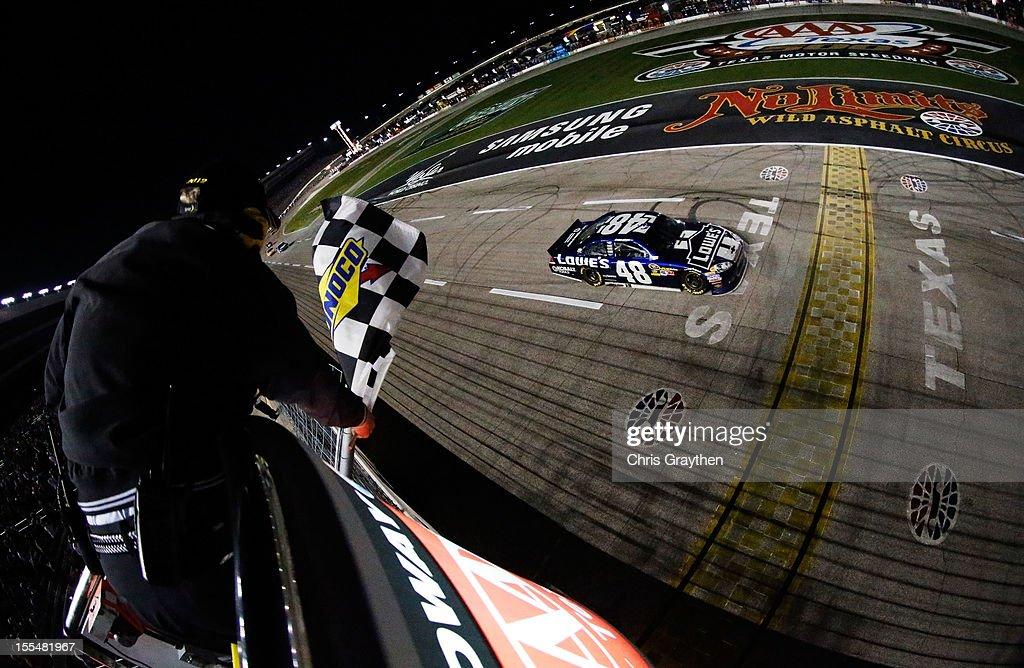 Jimmie Johnson, driver of the #48 Lowe's Chevrolet, crosses the finish line to win the NASCAR Sprint Cup Series AAA Texas 500 at Texas Motor Speedway on November 4, 2012 in Fort Worth, Texas.
