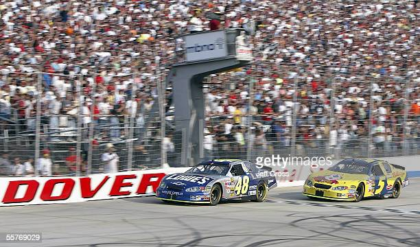 Jimmie Johnson driver of the Lowe's Chevrolet crosses the finish line ahead of Kyle Busch driver of the Kellogg's Chevrolet during the NASCAR Nextel...