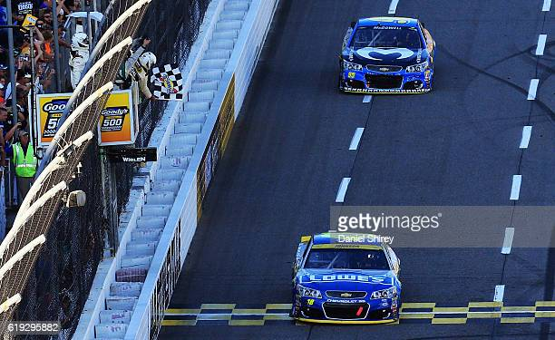 Jimmie Johnson driver of the Lowe's Chevrolet crosses the finish line to win the NASCAR Sprint Cup Series Goody's Fast Relief 500 at Martinsville...