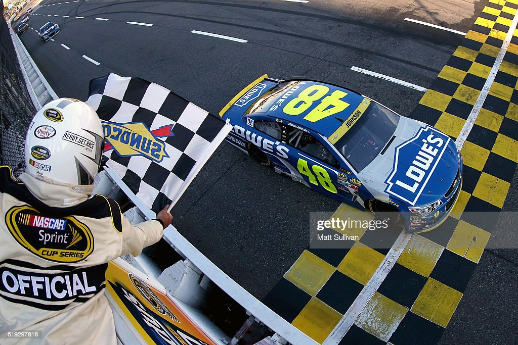 Jimmie Johnson, driver of the #48 Lowe's Chevrolet, crosses the finish line to win the NASCAR Sprint Cup Series Goody's Fast Relief 500 at Martinsville Speedway on October 30, 2016 in Martinsville, Virginia.