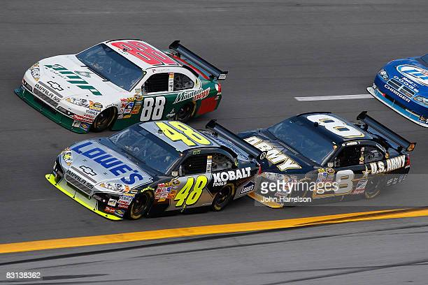 Jimmie Johnson, driver of the Lowe's Chevrolet, Dale Earnhardt Jr., driver of the AMP Energy Drive With Dale Jr./National Guard Chevrolet, and Aric...
