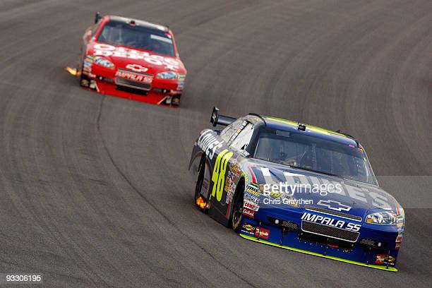 Jimmie Johnson driver of the Lowe's Chevrolet drives in front Juan Pablo Montoya driver of the Target Chevrolet during the NASCAR Sprint Cup Series...