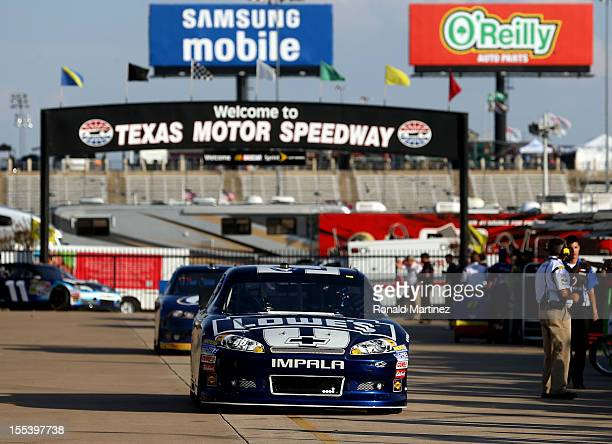 Jimmie Johnson driver of the Lowe's Chevrolet drives through the garage area during practice for the NASCAR Sprint Cup Series AAA Texas 500 at Texas...