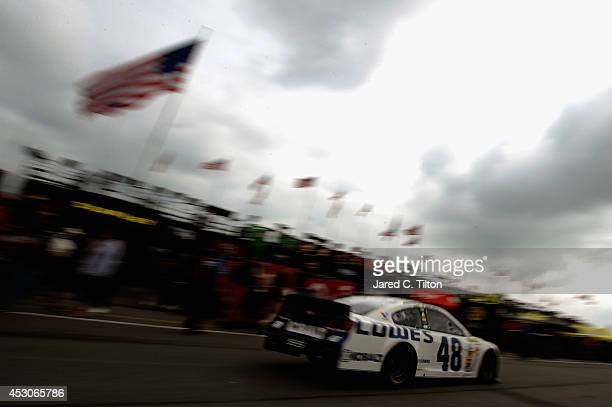 Jimmie Johnson driver of the Lowe's Chevrolet drives through the garage area during practice for the NASCAR Sprint Cup Series GoBowlingcom 400 at...