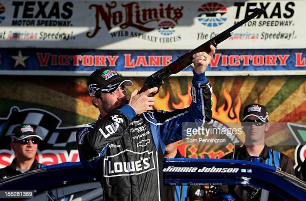 Jimmie Johnson driver of the Lowe's Chevrolet fires off the Pole Award Rifle after winning the pole position during qualifying for the NASCAR Sprint...