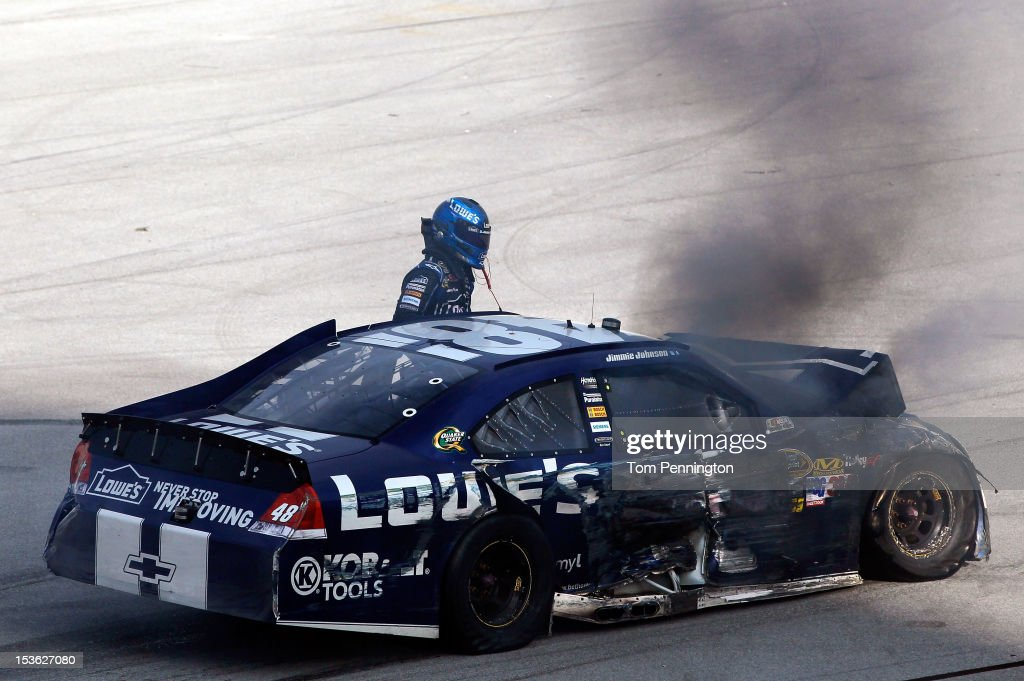 Jimmie Johnson, driver of the #48 Lowe's Chevrolet, gets out of his car as it smokes after an incident in the final lap of the NASCAR Sprint Cup Series Good Sam Roadside Assistance 500 at Talladega Superspeedway on October 7, 2012 in Talladega, Alabama.