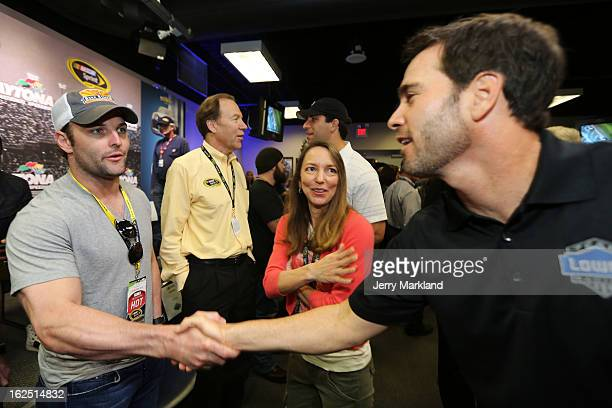 Jimmie Johnson driver of the Lowe's Chevrolet greets NFL player Wes Welker prior to the NASCAR Sprint Cup Series Daytona 500 at Daytona International...