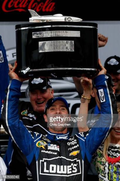 Jimmie Johnson driver of the Lowe's Chevrolet hoists the Harley J Earl trophy after winning the NASCAR Sprint Cup Series Daytona 500 at Daytona...