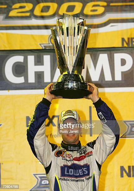 Jimmie Johnson driver of the Lowe's Chevrolet holds up the Nextel Cup after winning the 2006 NASCAR Nextel Cup Series Championship following the...