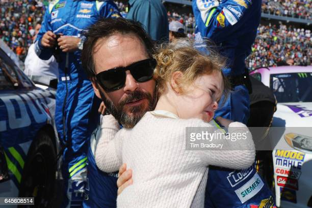 Jimmie Johnson driver of the Lowe's Chevrolet hugs his daughter Lydia Norriss prior to the 59th Annual DAYTONA 500 at Daytona International Speedway...