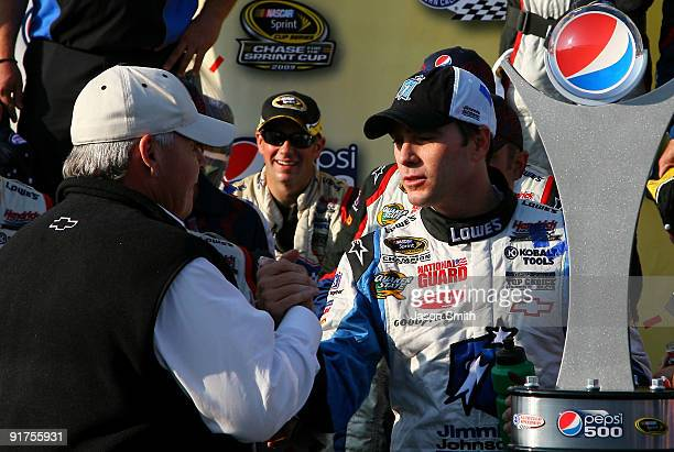 Jimmie Johnson driver of the Lowe's Chevrolet is congratulated by team owner Rick Hendrick in victory lane after winning the NASCAR Sprint Cup Series...