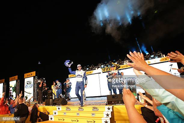 Jimmie Johnson driver of the Lowe's Chevrolet is introduced prior to the NASCAR Sprint Cup Series Sprint AllStar Race at Charlotte Motor Speedway on...