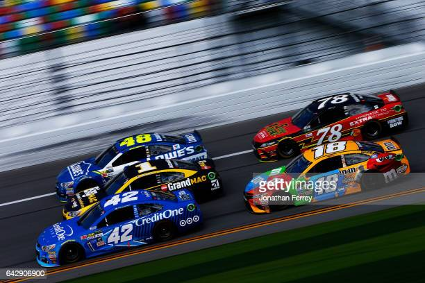 Jimmie Johnson driver of the Lowe's Chevrolet Jamie McMurray driver of the McDonald's Big Mac Chevrolet Kyle Larson driver of the Credit One Bank...