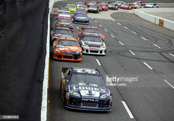 Jimmie Johnson driver of the Lowe's Chevrolet leads a group of cars during the NASCAR Sprint Cup Series Tums Fast Relief 500 at Martinsville Speedway...