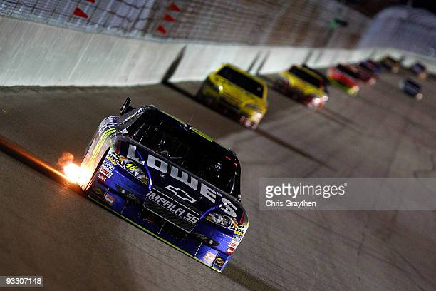 Jimmie Johnson driver of the Lowe's Chevrolet leads a group of cars during the NASCAR Sprint Cup Series Ford 400 at HomesteadMiami Speedway on...