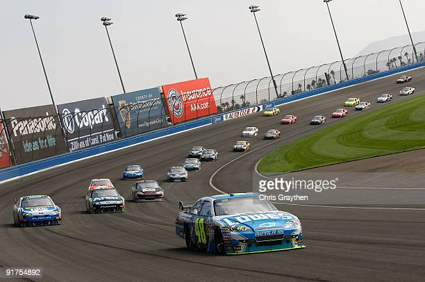 Jimmie Johnson driver of the Lowe's Chevrolet leads a line of cars during the NASCAR Sprint Cup Series Pepsi 500 at Auto Club Speedway on October 11...