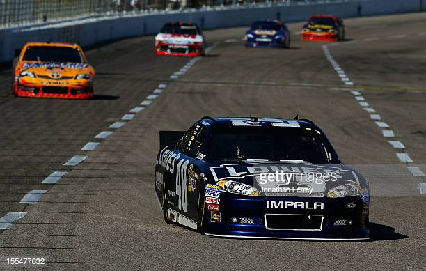 Jimmie Johnson driver of the Lowe's Chevrolet leads a pack of cars during the NASCAR Sprint Cup Series AAA Texas 500 at Texas Motor Speedway on...