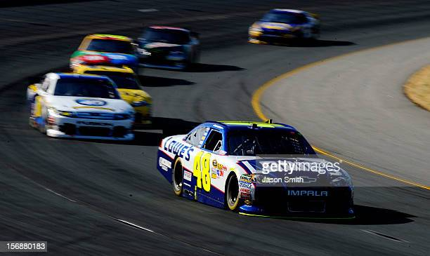 Jimmie Johnson driver of the Lowe's Chevrolet leads a pack of cars during the Sylvania 300 at the New Hampshire Motor Speedway at New Hampshire Motor...
