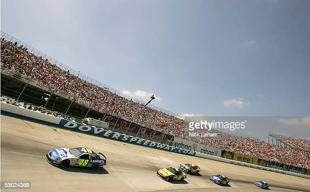 Jimmie Johnson driver of the Lowe's Chevrolet leads a pack on turn two during the NASCAR Nextel Cup MBNA RacePoints 400 on June 5 2005 at the Dover...