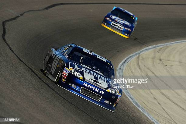 Jimmie Johnson driver of the Lowe's Chevrolet leads Brad Keselowski driver of the Miller Lite Dodge during the NASCAR Sprint Cup Series AAA Texas 500...
