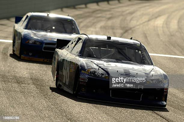 Jimmie Johnson driver of the Lowe's Chevrolet leads Brad Keselowski driver of the Miller Lite Dodge during the NASCAR Sprint Cup Series Ford EcoBoost...