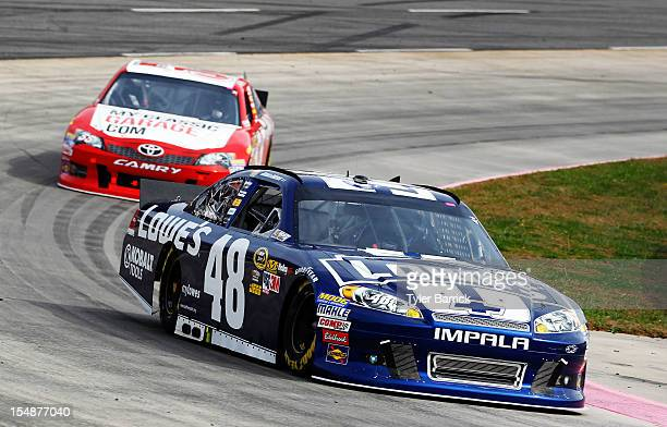 Jimmie Johnson driver of the Lowe's Chevrolet leads Brian Vickers driver of the MyClassicGaragecom Toyota during the NASCAR Sprint Cup Series Tums...