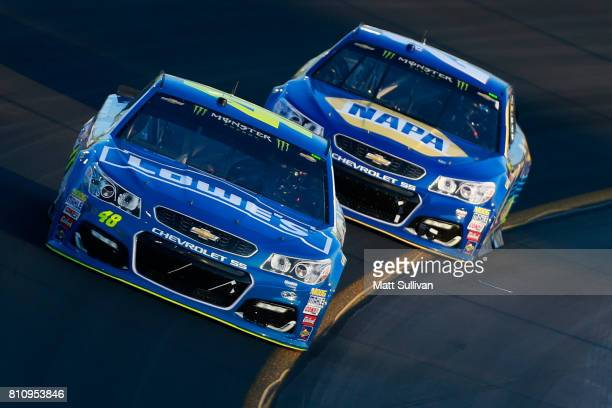 Jimmie Johnson driver of the Lowe's Chevrolet leads Chase Elliott driver of the NAPA Chevrolet during the Monster Energy NASCAR Cup Series Quaker...