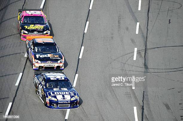 Jimmie Johnson driver of the Lowe's Chevrolet leads Denny Hamlin driver of the FedEx Express Toyota and Clint Bowyer driver of the 5Hour Energy...