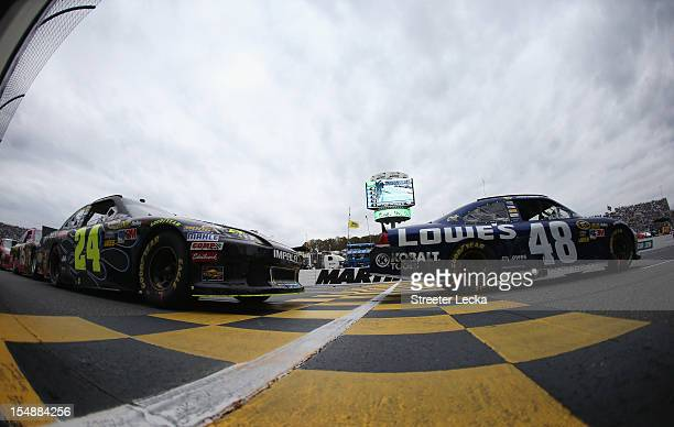 Jimmie Johnson driver of the Lowe's Chevrolet leads Jeff Gordon driver of the Pepsi Max Chevrolet during the NASCAR Sprint Cup Series Tums Fast...