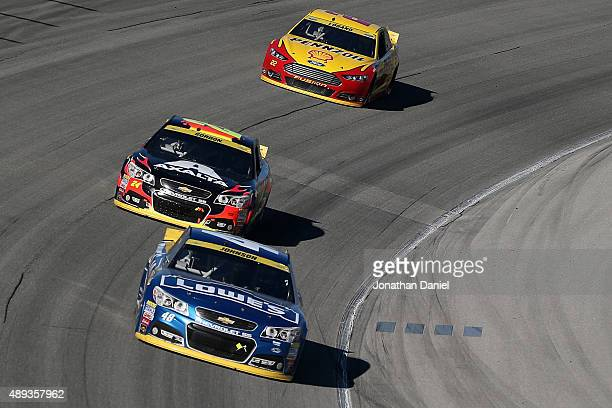 Jimmie Johnson driver of the Lowe's Chevrolet leads Jeff Gordon driver of the AXALTA Chevrolet and Joey Logano driver of the Shell Pennzoil Ford...