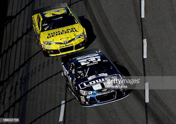 Jimmie Johnson driver of the Lowe's Chevrolet leads Matt Kenseth driver of the Dollar General Toyota during the NASCAR Sprint Cup Series Goody's...