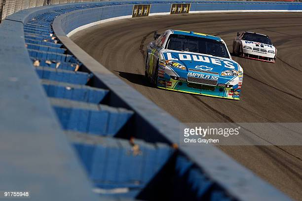 Jimmie Johnson driver of the Lowe's Chevrolet leads Sam Hornish Jr driver of the Mobil 1 Dodge during the NASCAR Sprint Cup Series Pepsi 500 at Auto...