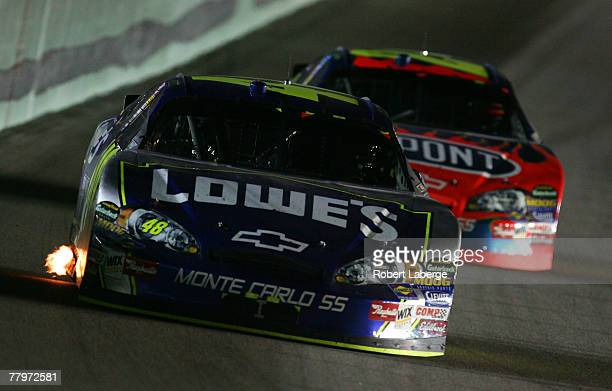 Jimmie Johnson driver of the Lowe's Chevrolet leads teammate Jeff Gordon driver of the DuPont Chevrolet during the NASCAR Nextel Cup Series Ford 400...