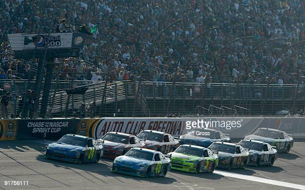 Jimmie Johnson driver of the Lowe's Chevrolet leads teammate Jeff Gordon driver of the Pepsi Chevrolet on a restart during the NASCAR Sprint Cup...