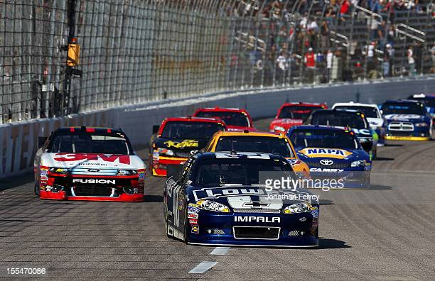 Jimmie Johnson driver of the Lowe's Chevrolet leads the field during the NASCAR Sprint Cup Series AAA Texas 500 at Texas Motor Speedway on November 4...