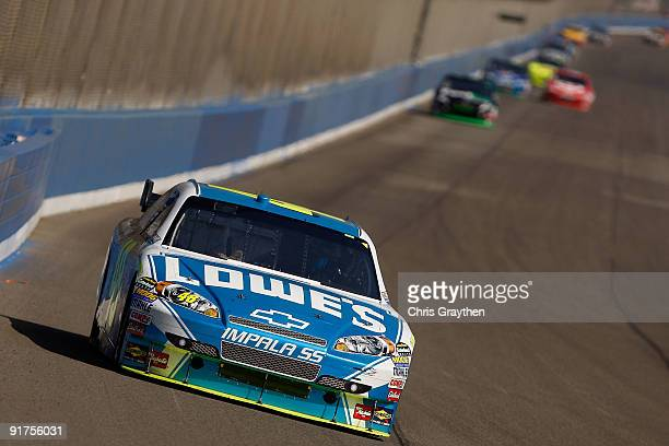 Jimmie Johnson driver of the Lowe's Chevrolet leads the field during the NASCAR Sprint Cup Series Pepsi 500 at Auto Club Speedway on October 11 2009...