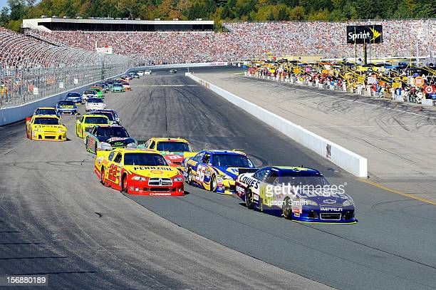 Jimmie Johnson driver of the Lowe's Chevrolet leads the field on a restart during the Sylvania 300 at the New Hampshire Motor Speedway at New...