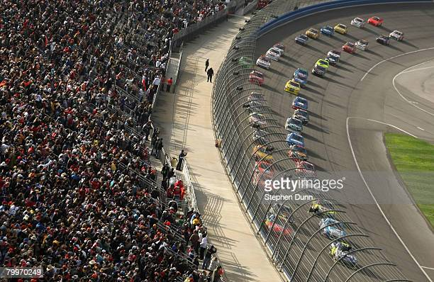 Jimmie Johnson, driver of the Lowe's Chevrolet, leads the field to the start of the NASCAR Sprint Cup Series Auto Club 500 at the Auto Club Speedway...