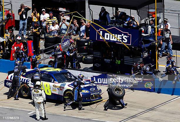 Jimmie Johnson driver of the Lowe's Chevrolet makes a four tire pit stop during the NASCAR Sprint Cup Series Aaron's 499 at Talladega Superspeedway...