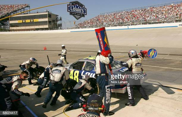 Jimmie Johnson driver of the Lowe's Chevrolet makes a pit stop during the NASCAR Nextel Cup MBNA RacePoints 400 on June 5 2005 at the Dover...