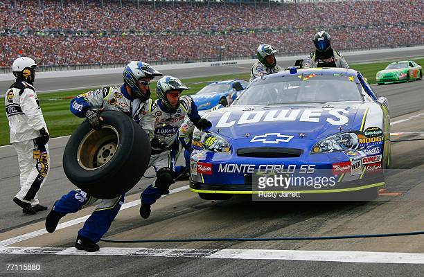 Jimmie Johnson, driver of the Lowe's Chevrolet, makes a pit stop during the NASCAR Nextel Cup Series LifeLock 400 at Kansas Speedway on September 30,...