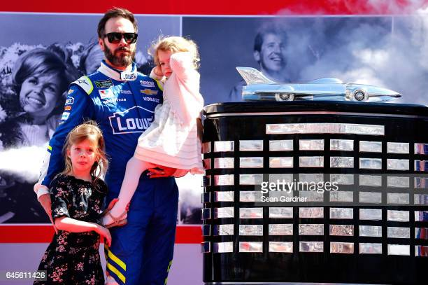 Jimmie Johnson driver of the Lowe's Chevrolet participates in the driver's intros with his daughters Genevieve Johnson and Lydia Norriss before 59th...
