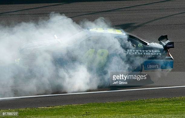 Jimmie Johnson driver of the Lowe's Chevrolet performs a burnout to celebrate winning the NASCAR Sprint Cup Series Pepsi 500 at Auto Club Speedway on...