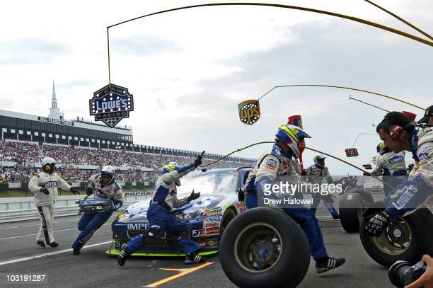 Jimmie Johnson driver of the Lowe's Chevrolet pits during the NASCAR Sprint Cup Series Sunoco Red Cross Pennsylvania 500 at Pocono Raceway on August...