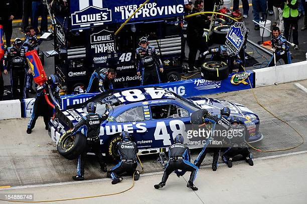 Jimmie Johnson driver of the Lowe's Chevrolet pits during the NASCAR Sprint Cup Series Tums Fast Relief 500 at Martinsville Speedway on October 28...